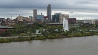 DX0002_169_034 - 5.7K stock footage aerial video of the city's skyline and park fountain seen from river, Downtown Omaha, Nebraska
