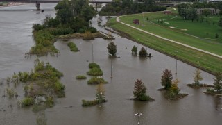 DX0002_169_040 - 5.7K stock footage aerial video of orbiting flooded parking lot in Council Bluffs, Iowa