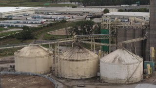 DX0002_170_005 - 5.7K stock footage aerial video storage tanks and grain elevator in Council Bluffs, Iowa
