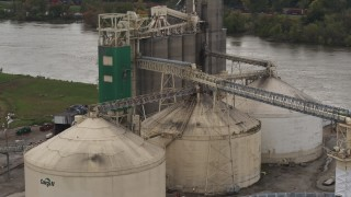 DX0002_170_009 - 5.7K stock footage aerial video approach storage tanks and grain elevator by river, Council Bluffs, Iowa