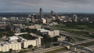 DX0002_170_010 - 5.7K stock footage aerial video of the city's skyline seen from university and apartment complex, Downtown Omaha, Nebraska