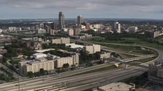 DX0002_170_015 - 5.7K stock footage aerial video view of the city's skyline seen from university and North Freeway, Downtown Omaha, Nebraska