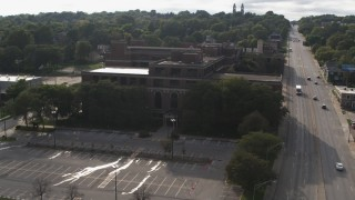 DX0002_170_020 - 5.7K stock footage aerial video orbit and fly away from the side of Omaha Adult High School in Omaha, Nebraska