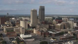 DX0002_170_022 - 5.7K stock footage aerial video of flying by skyscrapers towering over city buildings in Downtown Omaha, Nebraska