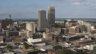 DX0002_170_026 - 5.7K stock footage aerial video of circling skyscrapers towering over city buildings in Downtown Omaha, Nebraska