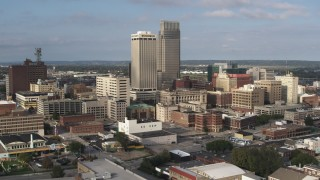DX0002_170_027 - 5.7K stock footage aerial video pass skyscrapers towering over city buildings in Downtown Omaha, Nebraska