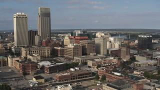 DX0002_170_028 - 5.7K stock footage aerial video orbit office buildings near skyscrapers in Downtown Omaha, Nebraska