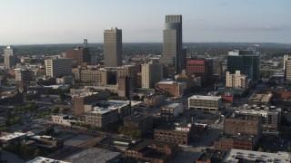 DX0002_170_041 - 5.7K stock footage aerial video slow orbit of the city's tall skyscrapers in Downtown Omaha, Nebraska