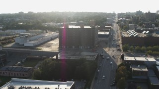 DX0002_170_049 - 5.7K stock footage aerial video a brick office building at sunset, Downtown Omaha, Nebraska