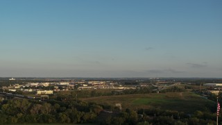 DX0002_172_002 - 5.7K stock footage aerial video of a wide, reverse view of the city at sunset, Council Bluffs, Iowa