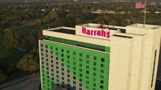 DX0002_172_004 - 5.7K stock footage aerial video approach the hotel and casino at sunset, tilt to bird's eye view, Council Bluffs, Iowa