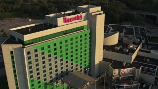 DX0002_172_005 - 5.7K stock footage aerial video fly away from the hotel and casino at sunset, Council Bluffs, Iowa