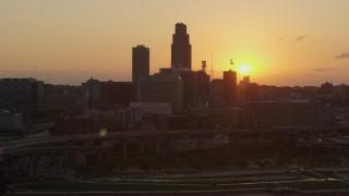 DX0002_172_031 - 5.7K stock footage aerial video slowly orbit the skyline, setting sun in background, Downtown Omaha, Nebraska