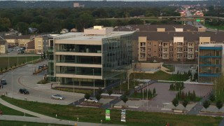 DX0002_172_033 - 5.7K stock footage aerial video of orbiting a modern office building at sunset in Council Bluffs, Iowa