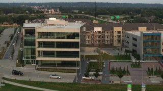 DX0002_172_034 - 5.7K stock footage aerial video of circling a modern office building at sunset in Council Bluffs, Iowa