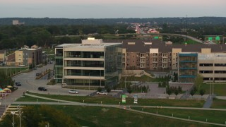 DX0002_172_036 - 5.7K stock footage aerial video orbit a modern office building at sunset in Council Bluffs, Iowa