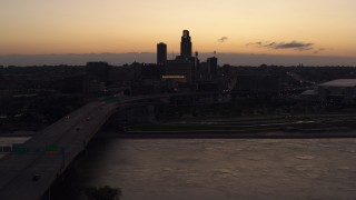 DX0002_172_037 - 5.7K stock footage aerial video approach skyline from bridge over the river at twilight, Downtown Omaha, Nebraska