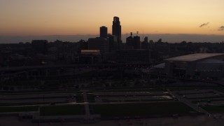 DX0002_172_038 - 5.7K stock footage aerial video of the skyline, reveal arena and convention center at twilight, Downtown Omaha, Nebraska