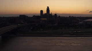 DX0002_172_041 - 5.7K stock footage aerial video of a reverse view of the skyline at twilight, Downtown Omaha, Nebraska