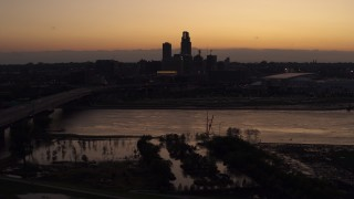 DX0002_172_042 - 5.7K stock footage aerial video of the skyline seen from bridge over the river at twilight, Downtown Omaha, Nebraska