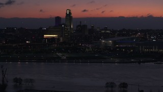 DX0002_173_004 - 5.7K stock footage aerial video of flying by skyscrapers in the skyline at twilight, Downtown Omaha, Nebraska