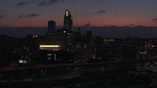 DX0002_173_007 - 5.7K stock footage aerial video of ascending toward the city's skyline at twilight, Downtown Omaha, Nebraska