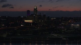 DX0002_173_009 - 5.7K stock footage aerial video of a reverse view of the city's skyline at twilight, reveal the river, Downtown Omaha, Nebraska