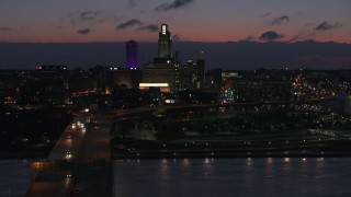 DX0002_173_010 - 5.7K stock footage aerial video of a view of the city's skyline at twilight, seen from the river, Downtown Omaha, Nebraska
