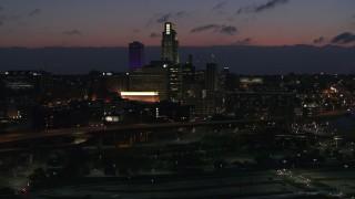 DX0002_173_011 - 5.7K stock footage aerial video flyby the city's skyline at twilight, Downtown Omaha, Nebraska