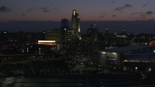 DX0002_173_012 - 5.7K stock footage aerial video reverse view and flyby the city's skyline at twilight, Downtown Omaha, Nebraska