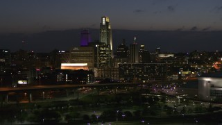 DX0002_173_014 - 5.7K stock footage aerial video of slowly flying by the city's skyline at twilight, Downtown Omaha, Nebraska