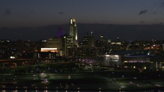 DX0002_173_015 - 5.7K stock footage aerial video of passing by the city's skyline at twilight, Downtown Omaha, Nebraska