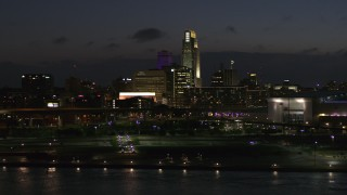 DX0002_173_017 - 5.7K stock footage aerial video ascend and fly past the city's skyline at twilight, Downtown Omaha, Nebraska