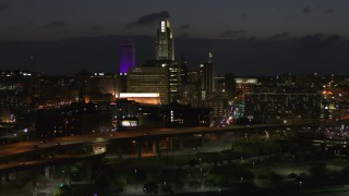 DX0002_173_018 - 5.7K stock footage aerial video approach the city's skyline at twilight, Downtown Omaha, Nebraska