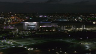 DX0002_173_024 - 5.7K stock footage aerial video orbit and approach arena and convention center complex at night, Downtown Omaha, Nebraska