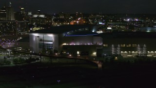 DX0002_173_025 - 5.7K stock footage aerial video orbit arena and convention center complex at night, Downtown Omaha, Nebraska