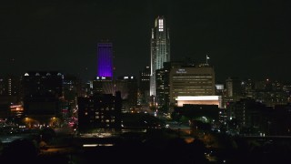 DX0002_173_056 - 5.7K stock footage aerial video of towering skyscrapers and high-rises at night, Downtown Omaha, Nebraska