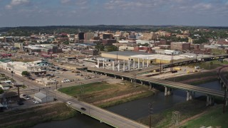 DX0002_174_001 - 5.7K stock footage aerial video reverse view of riverfront warehouses near downtown, Sioux City, Iowa