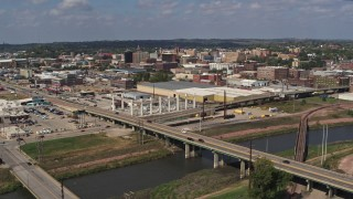 DX0002_174_002 - 5.7K stock footage aerial video of flying by bridges and riverfront warehouses near downtown, Sioux City, Iowa