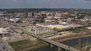 DX0002_174_003 - 5.7K stock footage aerial video ascend and fly away from bridges and riverfront warehouses near downtown, Sioux City, Iowa