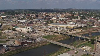 DX0002_174_004 - 5.7K stock footage aerial video approach bridges and riverfront warehouses near downtown, Sioux City, Iowa