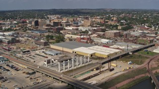 DX0002_174_005 - 5.7K stock footage aerial video fly over bridges to approach riverfront warehouses near downtown, Sioux City, Iowa
