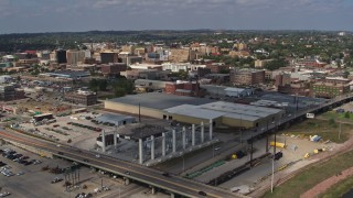 DX0002_174_006 - 5.7K stock footage aerial video descend and fly away from riverfront warehouses near downtown, reveal river, Sioux City, Iowa