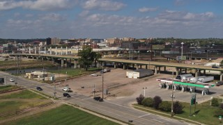 DX0002_174_007 - 5.7K stock footage aerial video flying by the Gordon Drive bridge and a gas station, Sioux City, Iowa