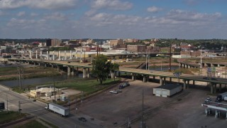 DX0002_174_008 - 5.7K stock footage aerial video ascend by bridge for view of warehouse and downtown, Sioux City, Iowa