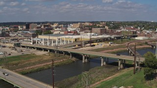 DX0002_174_011 - 5.7K stock footage aerial video descend by bridges with view of warehouses and downtown, Sioux City, Iowa