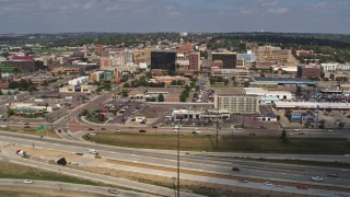 DX0002_174_012 - 5.7K stock footage aerial video ascending with a view of office buildings in Downtown Sioux City, Iowa
