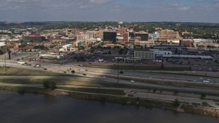 DX0002_174_014 - 5.7K stock footage aerial video of office buildings and I-29 seen from the river, Downtown Sioux City, Iowa