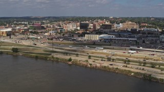 DX0002_174_015 - 5.7K stock footage aerial video of office buildings and I-29 seen while descending by the river, Downtown Sioux City, Iowa