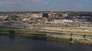 DX0002_174_016 - 5.7K stock footage aerial video of flying by I-29 with a view of Downtown Sioux City, Iowa